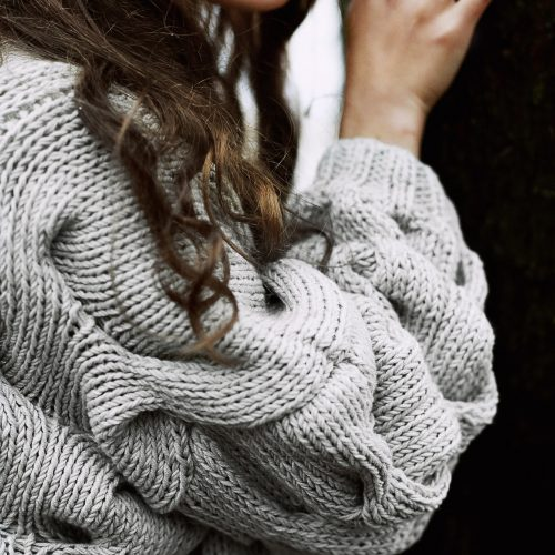 woman-wearing-gray-knitted-sweater-1452787